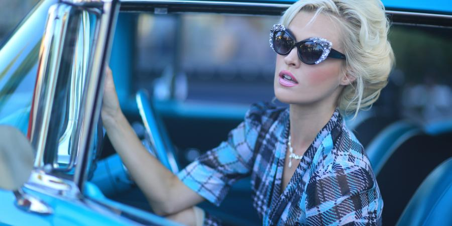 Fashionable woman in vintage car
